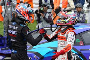Race winner Jenson Button, Team Kunimitsu and Tomoki Nojiri, Autobacs Racing Team Aguri