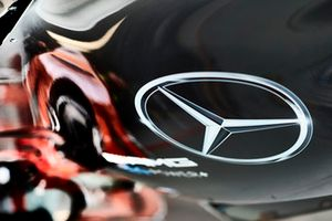 A Mercedes logo on an engine cover