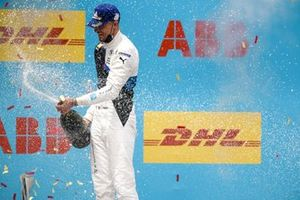 Race Winner Jake Dennis, BMW i Andretti Motorsport celebrates on the podium with the champagne