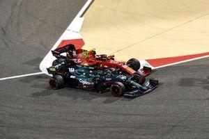 Lance Stroll, Aston Martin AMR21, battles with Carlos Sainz Jr., Ferrari SF21