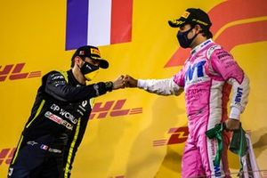 Esteban Ocon, Renault F1, 2nd position, and Sergio Perez, Racing Point, 1st position, congratulate each other on the podium