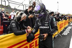 Pole man Lewis Hamilton, Mercedes, celebrates with his team on arrival in Parc Ferme
