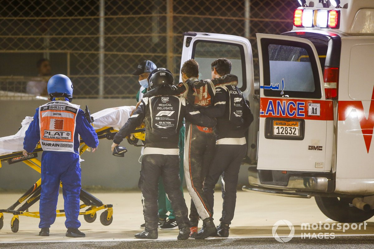 Medical delegates assist Romain Grosjean, Haas F1, after a huge crash on the opening lap