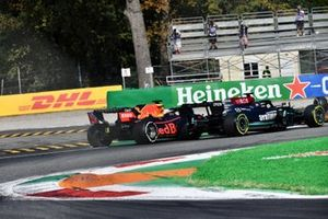 Max Verstappen, Red Bull Racing RB16B, and Lewis Hamilton, Mercedes W12, collide