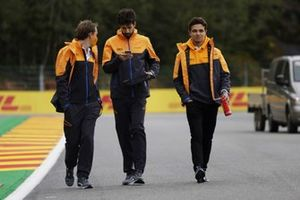 Lando Norris, McLaren, walks the track with members of his team