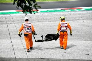 Marshals remove bodywork from the crash of Mick Schumacher, Haas F1, in FP3