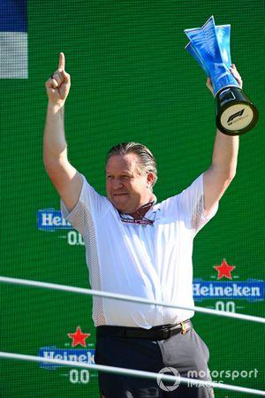 Zak Brown, CEO, McLaren Racing, lifts the Constructors trophy