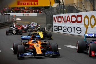 Carlos Sainz Jr., McLaren MCL34, leads Nico Hulkenberg, Renault R.S. 19, and Romain Grosjean, Haas F1 Team VF-19