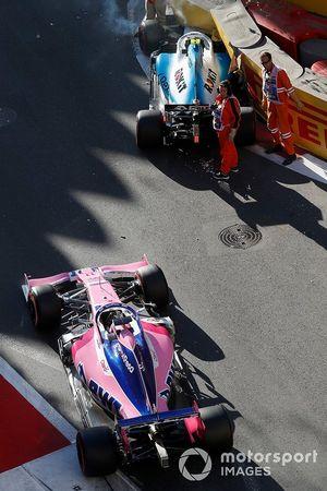 Crews remove the crashed car of Robert Kubica, Williams