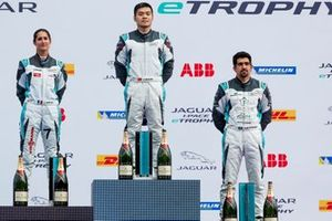 Yaqi Zhang, Team China, 1st position, Célia Martin, Viessman Jaguar eTROPHY Team Germany, 2nd position, Ahmed Bin Khanen, Saudi Racing, 3rd position, celebrate on the podium