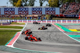 Sebastian Vettel, Ferrari SF90, leads Charles Leclerc, Ferrari SF90, Pierre Gasly, Red Bull Racing RB15, Romain Grosjean, Haas F1 Team VF-19, and Kevin Magnussen, Haas F1 Team VF-19