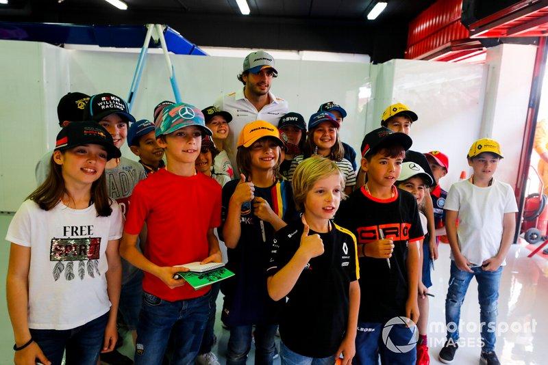 Carlos Sainz Jr., McLaren, meets some young fans