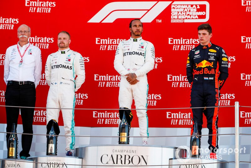 Dr Dieter Zetsche, CEO, Mercedes Benz, Valtteri Bottas, Mercedes AMG F1, 2nd position, Lewis Hamilton, Mercedes AMG F1, 1st position, and Max Verstappen, Red Bull Racing, 3rd position, on the podium