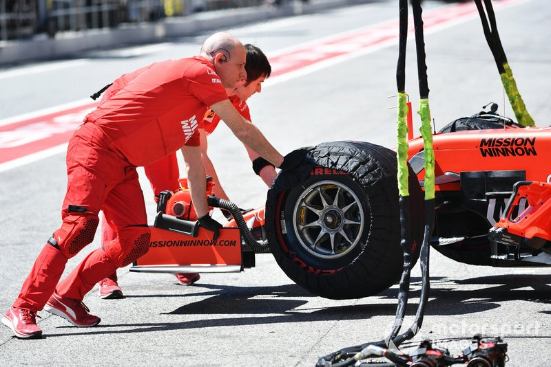 Charles Leclerc, Ferrari SF90, is returned to the garage