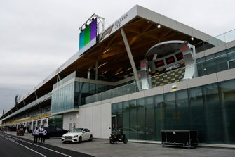 The podium and Paddock Club building