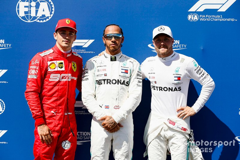 Charles Leclerc, Ferrari, Pole Sitter Lewis Hamilton, Mercedes AMG F1 and Valtteri Bottas, Mercedes AMG F1 celebrate in Parc Ferme