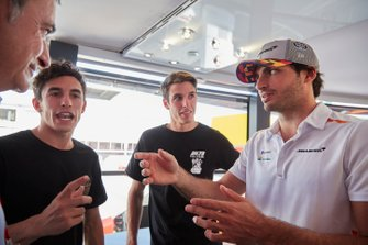 Moto GP riders Alex and Marc Marquez with Carlos Sainz Jr., McLaren and his father