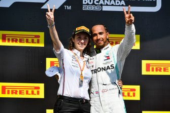 Lewis Hamilton, Mercedes AMG F1 and Mercedes constructors representative celebrate on the podium
