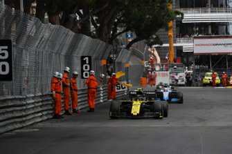 Nico Hulkenberg, Renault R.S. 19, leads George Russell, Williams Racing FW42, past some marshals