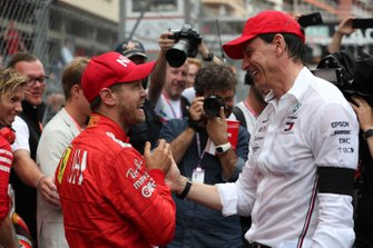 Sebastian Vettel, Ferrari, 2nd position, talks with Toto Wolff, Executive Director (Business), Mercedes AMG