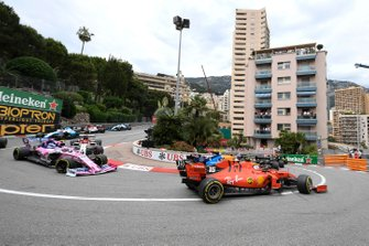 Charles Leclerc, Ferrari SF90, leads Lance Stroll, Racing Point RP19, and Kimi Raikkonen, Alfa Romeo Racing C38