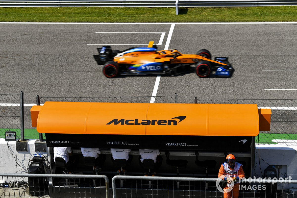 Carlos Sainz Jr., McLaren MCL35, passes the McLaren pit wall