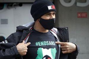 Lewis Hamilton, Mercedes-AMG F1, wears an End SARS teeshirt