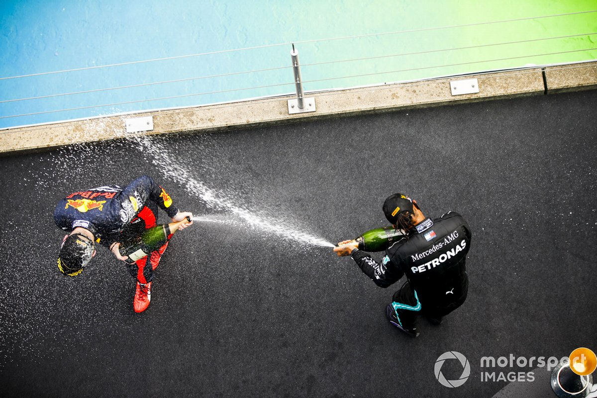 Max Verstappen, Red Bull Racing and Race Winner Lewis Hamilton, Mercedes-AMG F1 celebrates on the podium with the chamapgne
