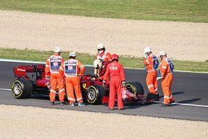 Marshals gather around the stopped car of Sebastian Vettel, Ferrari SF1000