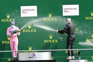 Dylan Pereira, BWT Lechner Racing, 2nd position, and Florian Latorre, CLRT, 3rd position, spray Champagne on the podium