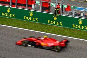 Charles Leclerc, Ferrari SF1000, passes his pit board