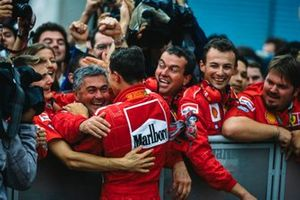 Michael Schumacher celebrates victory in the race and the championship with his Ferrari team in Parc Ferme
