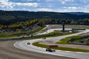 Valtteri Bottas, Mercedes F1 W11, Kevin Magnussen, Haas VF-20, and Sebastian Vettel, Ferrari SF1000