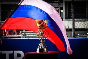 The trophy and a Russian flag on the grid