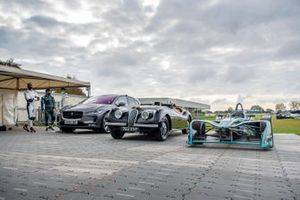 A line-up of Jaguars, including I-Pace, XK120 and Formua E car. Mitch Evans and Karun Chandhok stand by