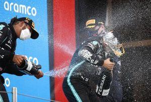 Lewis Hamilton, Mercedes1st sprays Valtteri Bottas, Mercedes, 3rd position, with Champagne