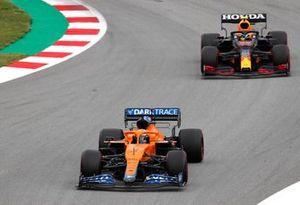 Daniel Ricciardo, McLaren MCL35M, leads Sergio Perez, Red Bull Racing RB16B