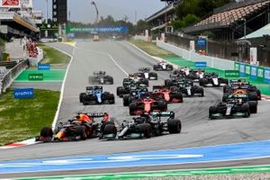 Max Verstappen, Red Bull Racing RB16B and Sir Lewis Hamilton, Mercedes W12 battle at the start of the race
