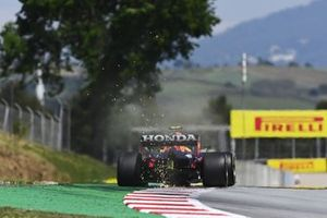 Sparks kick up from the rear of Sergio Perez, Red Bull Racing RB16B
