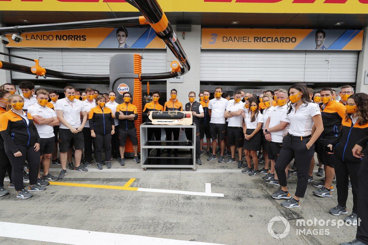 Lando Norris and members of the McLaren team, with a birthday cake from Daniel Ricciardo