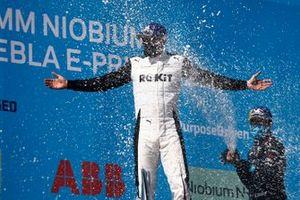 Nick Cassidy, Envision Virgin Racing, third position, sprays Edoardo Mortara, Venturi Racing, first position, with Champagne