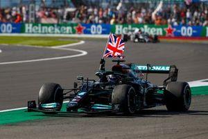 Lewis Hamilton, Mercedes W12, 1st position, flies the flag from his cockpit