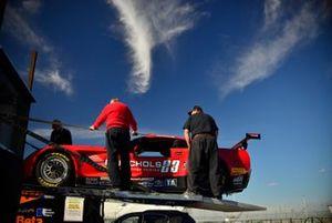 Crew members unload the #23 TA Chevrolet Corvette driven by Amy Ruman of Ruman Racing