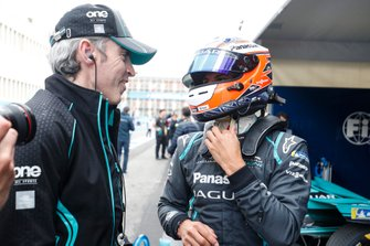 Mitch Evans, Panasonic Jaguar Racing, with a team member.
