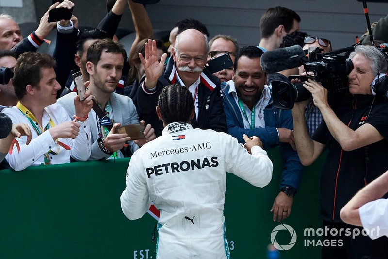 Lewis Hamilton, Mercedes AMG F1, 1st position, celebrates with Dr Dieter Zetsche, CEO, Mercedes Benz, and the Mercedes team in Parc Ferme