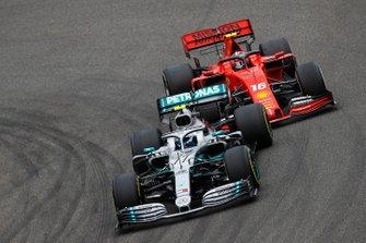 Valtteri Bottas, Mercedes AMG W10, battles with Charles Leclerc, Ferrari SF90