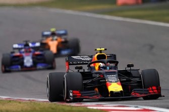 Pierre Gasly, Red Bull Racing RB15, leads Daniil Kvyat, Toro Rosso STR14, and Lando Norris, McLaren MCL34