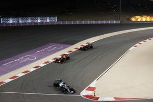 Valtteri Bottas, Mercedes AMG W10, leads Max Verstappen, Red Bull Racing RB15, and Kevin Magnussen, Haas F1 Team VF-19