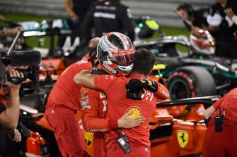 Charles Leclerc, Ferrari, celebrates pole with his mechanics
