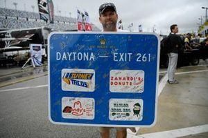 Fan with autograph board in the Daytona paddock